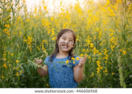 Portrait of happy Asian girl fills free in the flower field, Freedom concept