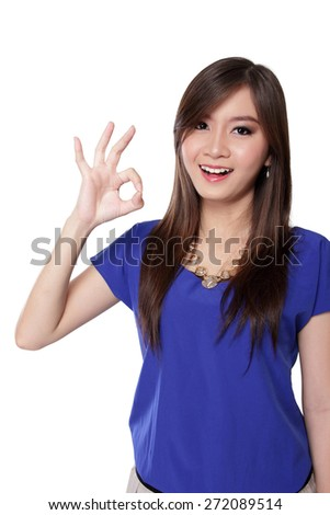 Portrait of happy Asian girl making okay hand gestures, isolated on white background - stock photo