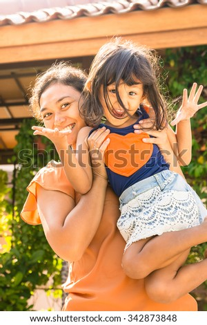 Portrait of Happy Asian Mother Fun Together with Her Little Girl - stock photo