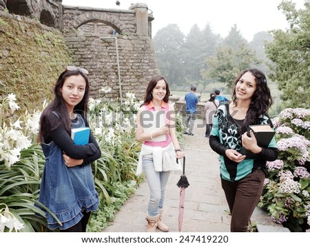 Portrait of happy Asian students in university. - stock photo
