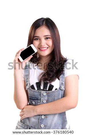 Portrait of happy attractive Asian girl posing with her smartphone, isolated on white background - stock photo