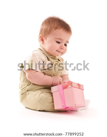 Portrait of happy baby boy with small pink gift box - stock photo