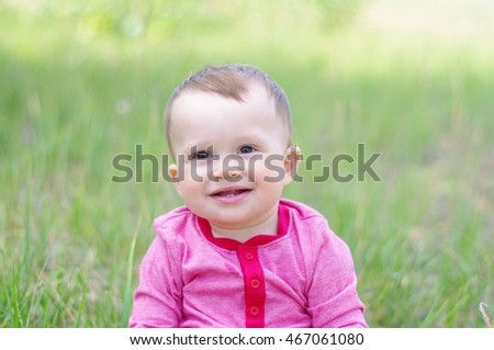 portrait of happy baby in summer outdoors