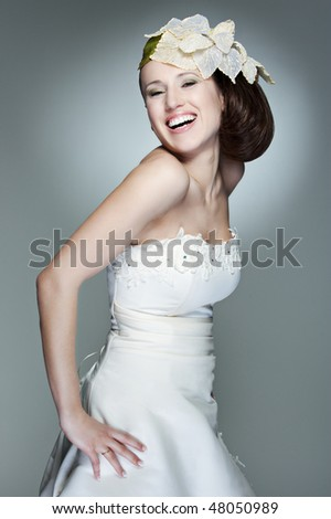portrait of happy beautiful bride against grey background - stock photo