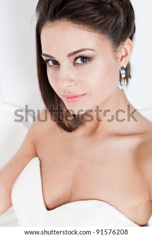 Portrait of happy beautiful bride against white background