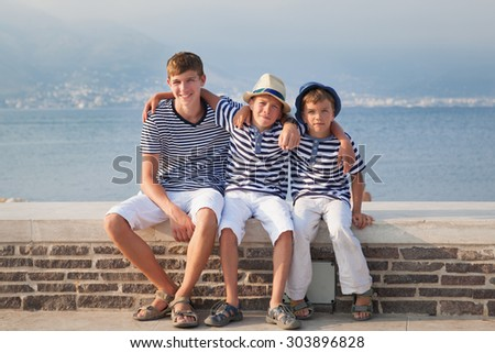 Portrait of Happy beautiful brothers near  sea, italy,