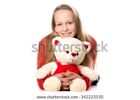 Portrait of happy beautiful casual teenage girl in red leather jacket hugging teddy bear, friendly smiling, looking at camera with cheerful expression, studio, white background - stock photo