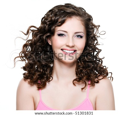 Portrait of happy beautiful cheerful woman with long curly brown hair - stock photo