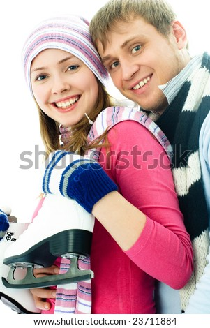 portrait of happy beautiful cheerful young couple going ice-skating