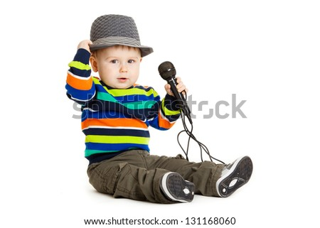 Portrait of happy beautiful little boy isolated on white background. Baby and a microphone. - stock photo