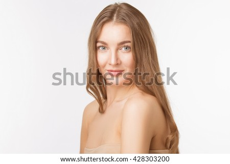 Portrait of happy beautiful shirtless lady looking at camera and posing for photographer over white background. Studio shot.