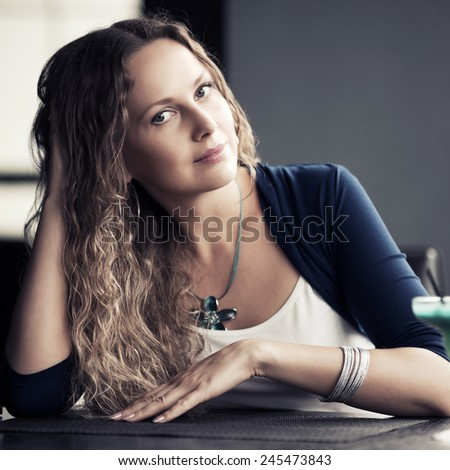 Portrait of happy beautiful woman with long curly hairs