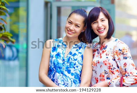 portrait of happy beautiful women outdoors - stock photo