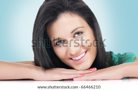 Portrait of happy beautiful young woman.