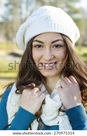 Portrait of Happy Beautiful Young Woman in the park. Winter or autumn season outdoor. - stock photo