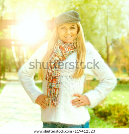 Portrait of happy beautiful young woman outdoors.