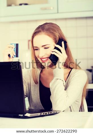 Portrait of happy blond woman using laptop - stock photo