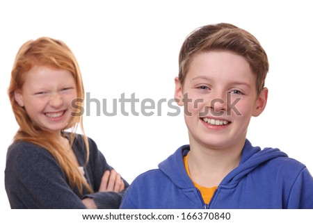 Portrait of happy boy and girl on white background