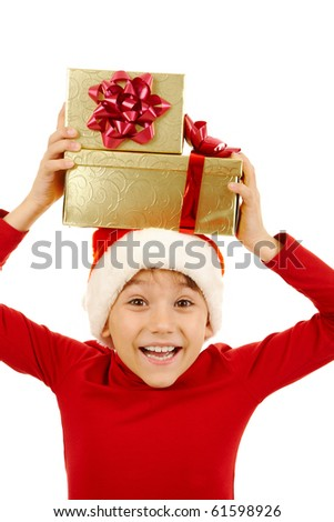 Portrait of happy boy holding giftboxs above his head and expressing surprise - stock photo