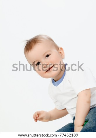 Portrait of happy boy laughing on white background