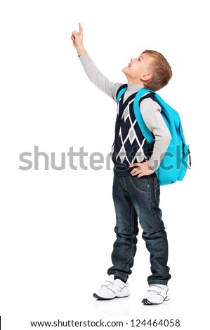 Portrait of happy boy with backpack showing something isolated on white background - stock photo