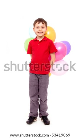 Portrait of happy boy with colorful balloons at birthday party - stock photo