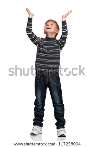 Portrait of happy boy with hands up isolated on white background - stock photo