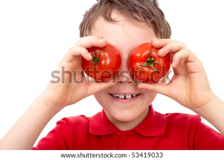 Portrait of happy boy with ripe tomatoes before his eyes - stock photo