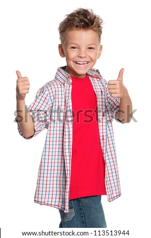 Portrait of happy boy with thumbs up isolated on white background - stock photo