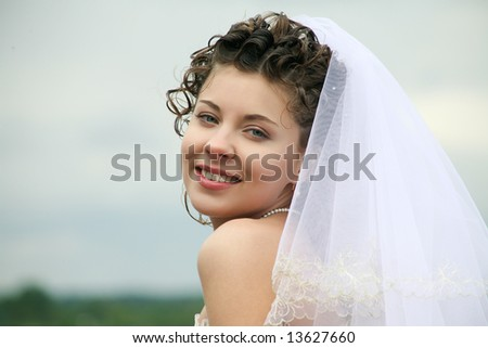 Portrait of happy bride looking at camera with smile