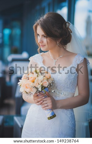 portrait of happy bride with a bouquet in hands