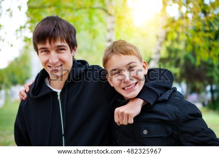 Portrait of Happy Brothers in the Autumn Park