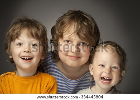 portrait of happy brothers on a gray background - stock photo