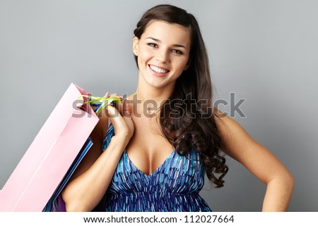 Portrait of happy brunette with paperbags after shopping
