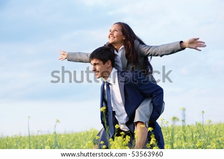 Portrait of happy business partners enjoying life and freedom in meadow