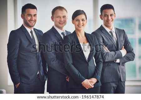 Portrait of happy business partners looking at camera - stock photo