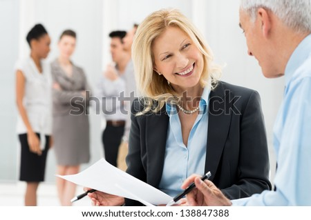 Portrait Of Happy Business People Discussing Together In Office - stock photo