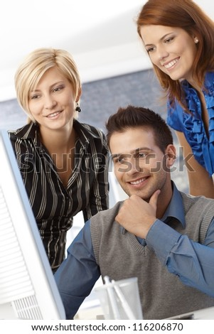 Portrait of happy business team at work, smiling. - stock photo
