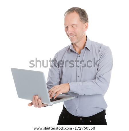 Portrait Of Happy Businessman Holding Laptop Isolated On White Background - stock photo