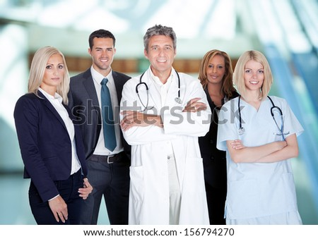 Portrait Of Happy Businesspeople And Medical Workers Indoor - stock photo