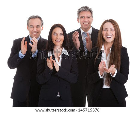 Portrait Of Happy Businesspeople Clapping Over White Background - stock photo