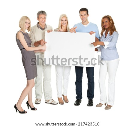 Portrait of happy businesspeople showing a blank board on white background - stock photo