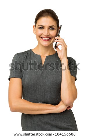Portrait of happy businesswoman answering smart phone against white background. Vertical shot. - stock photo