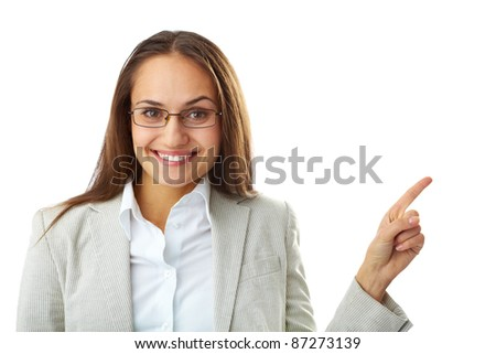 Portrait of happy businesswoman looking at camera with her forefinger showing aside