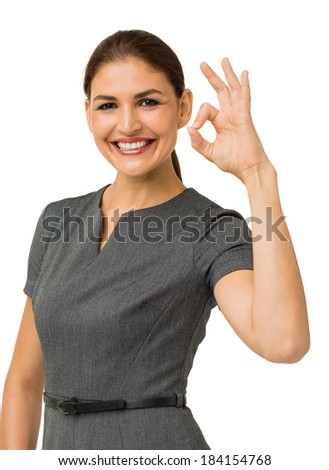 Portrait of happy businesswoman showing okay sign over white background. Vertical shot. - stock photo
