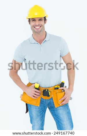 Portrait of happy carpenter wearing hard hat over white background - stock photo