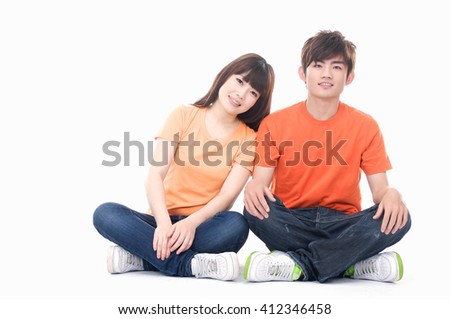 Portrait of Happy casual young couple sitting