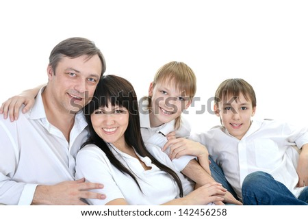 Portrait of happy Caucasian family of four on a light background