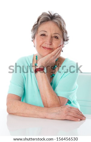 Portrait of happy caucasian older woman isolated over white. - stock photo