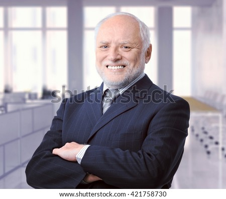 Portrait of happy caucasian senior business executive advisor at office. Smiling, successful, suit and tie, looking at camera, arms crossed. - stock photo